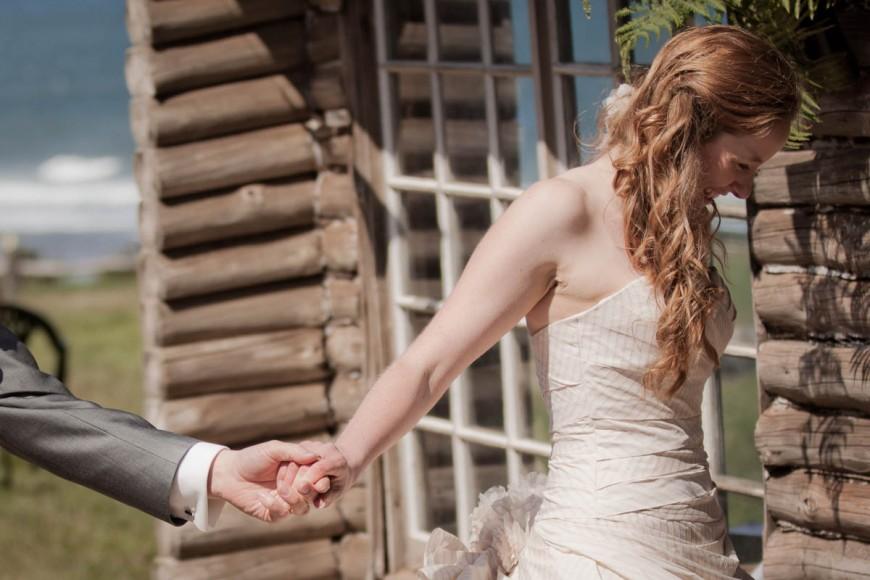 Bride leads groom into wedding recption at ravensheugh log cabin