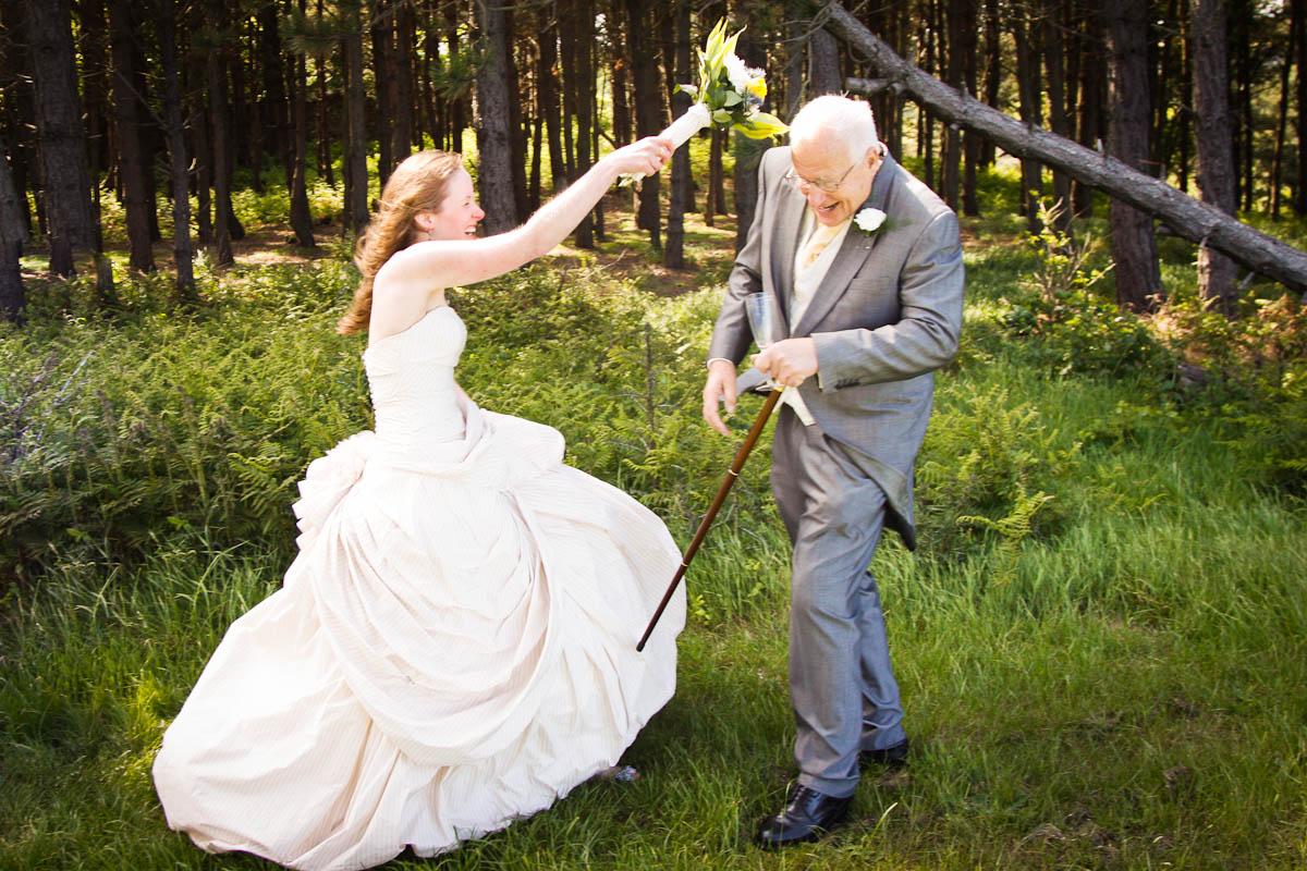 bride gets violent with bouquet at outdoor beach wedding