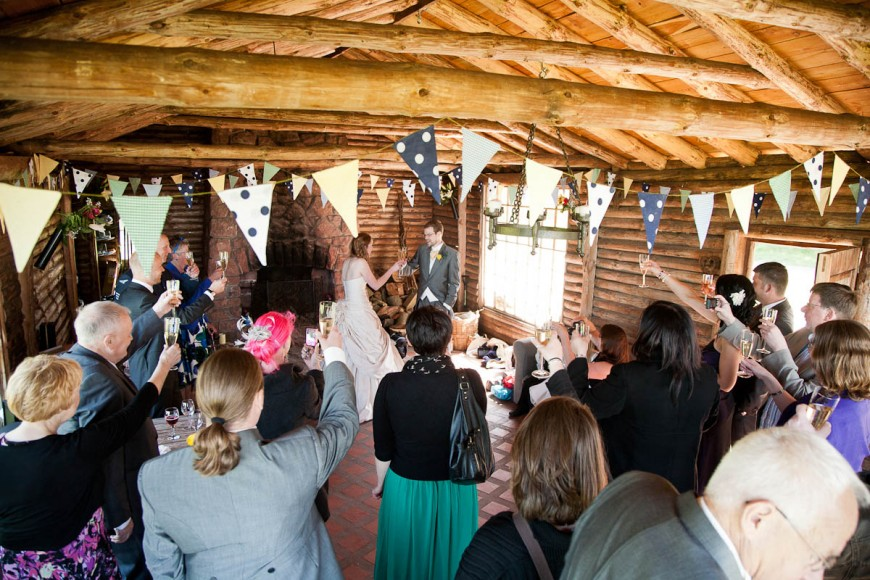 toast raised to bride ad groom at wedding at Ravensheugh log cabin