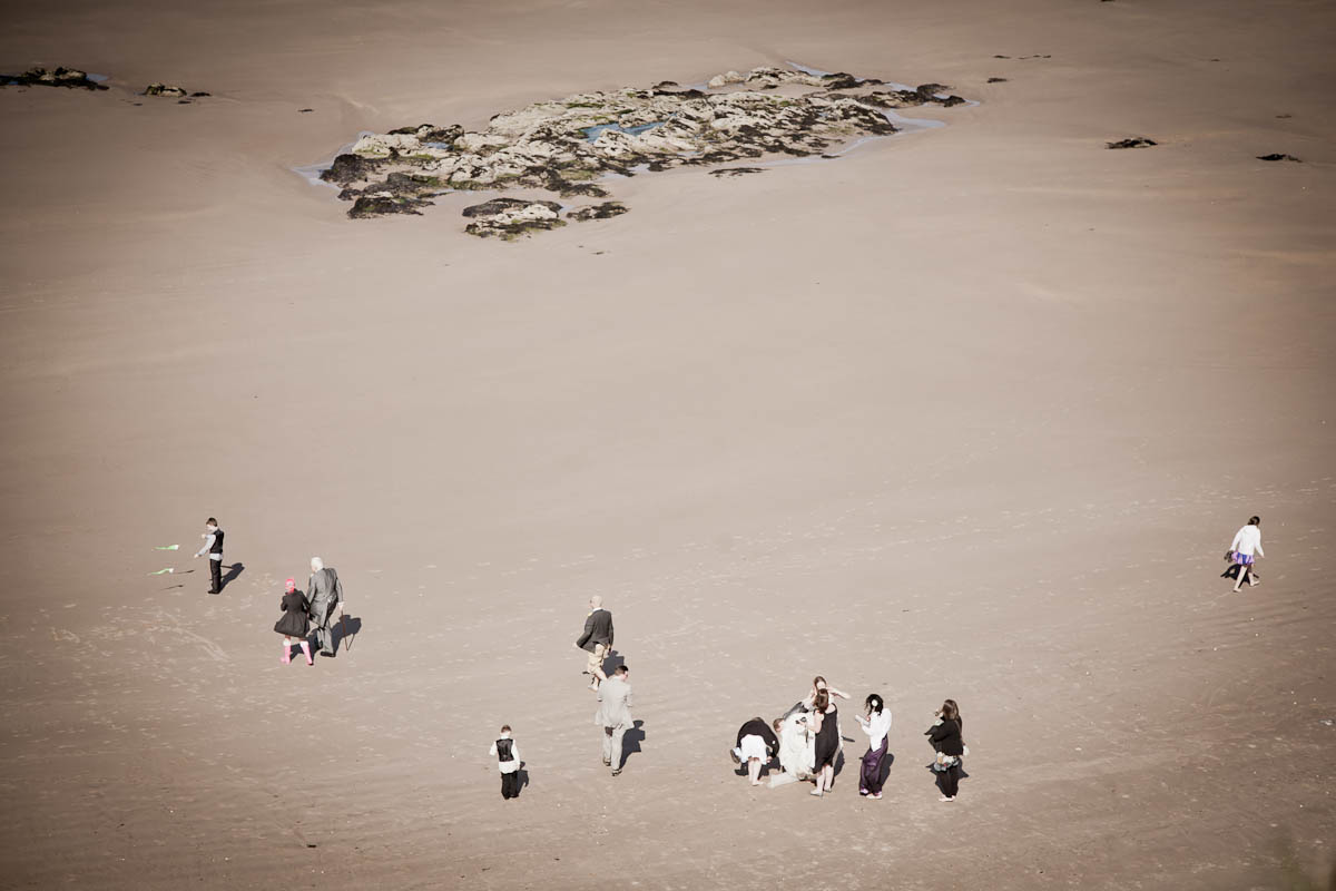 wedding guests on beach