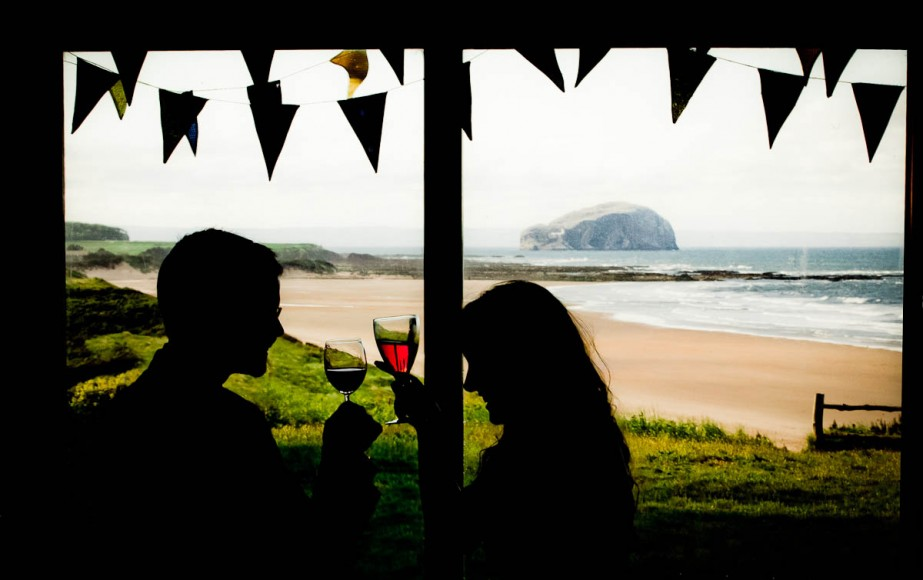 wedding guests drink at ravensheugh log cabin
