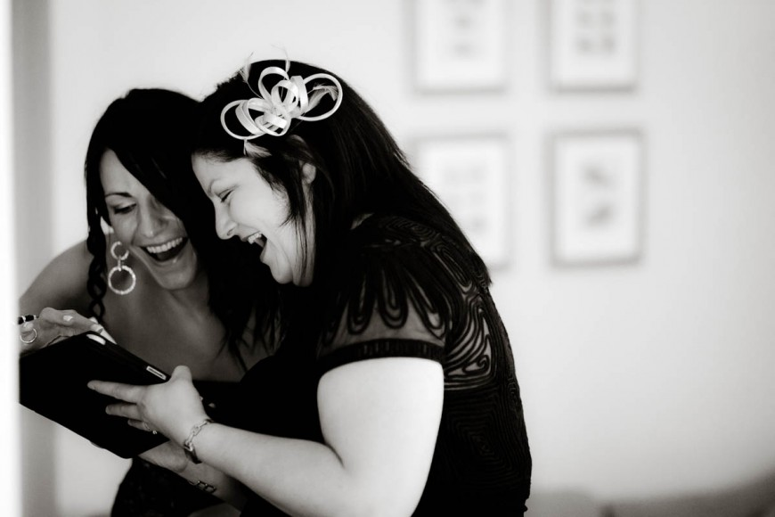wedding guests laugh at ipad