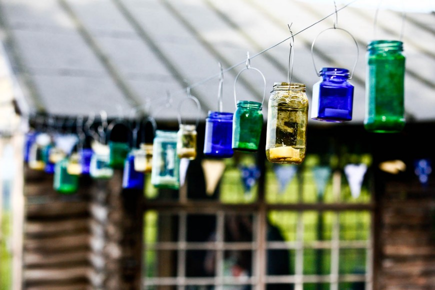 tea light in hanging jam jars at wedding