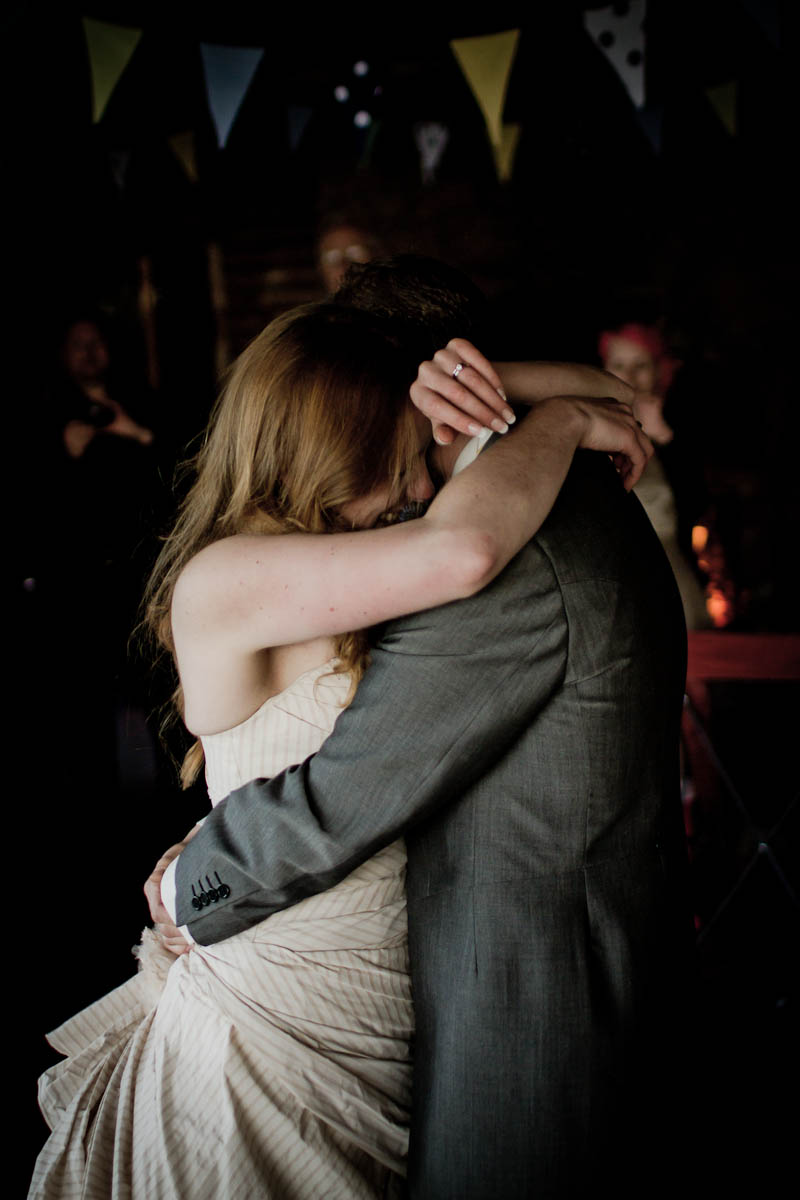 bride and groom first dance at log cabin wedding