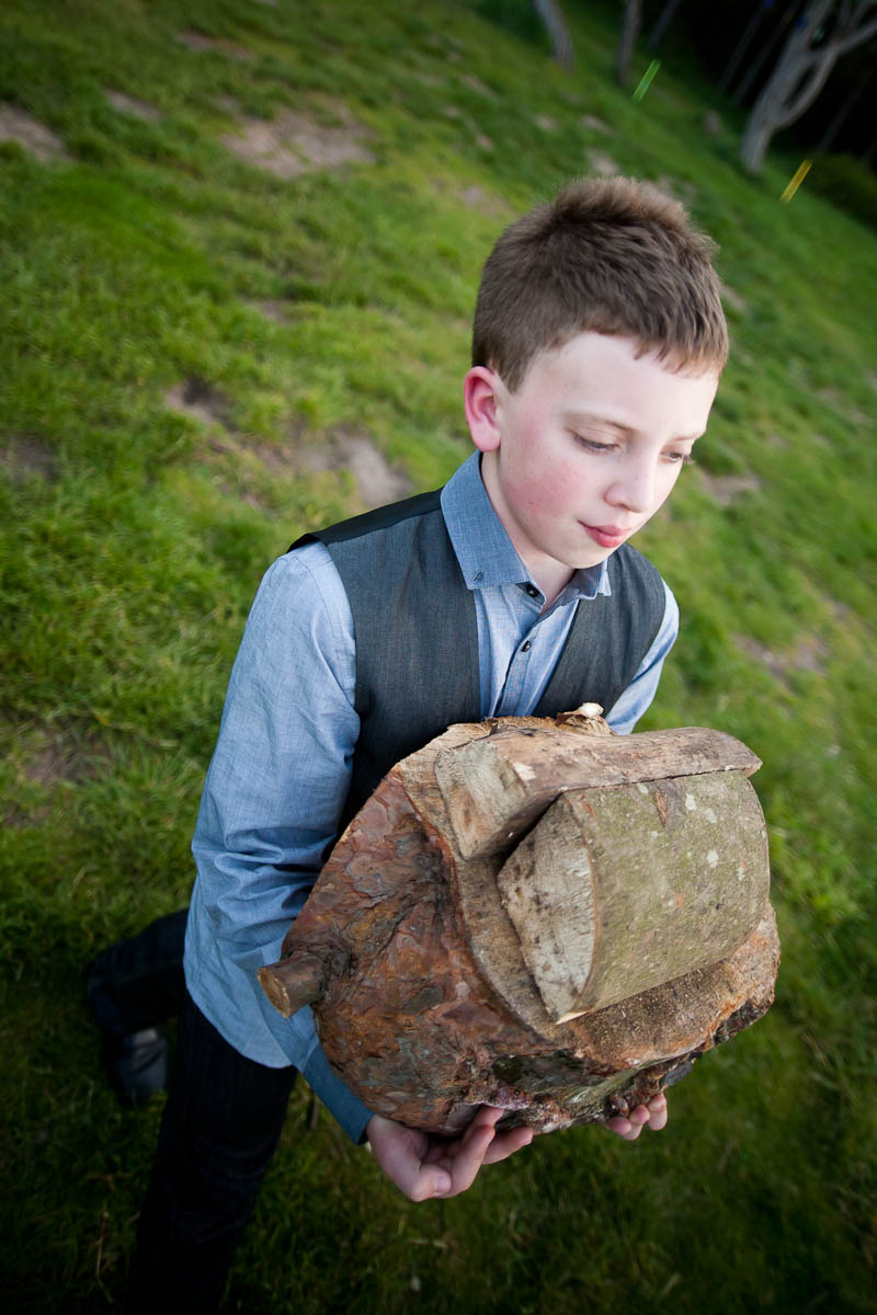 boy with logs for firewood at wedding
