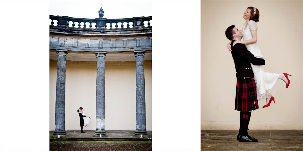 Groom lifts bride by the pillars of Hopetoun House