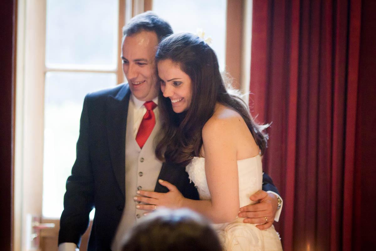groom with arm round bride at wedding at drummuir castle