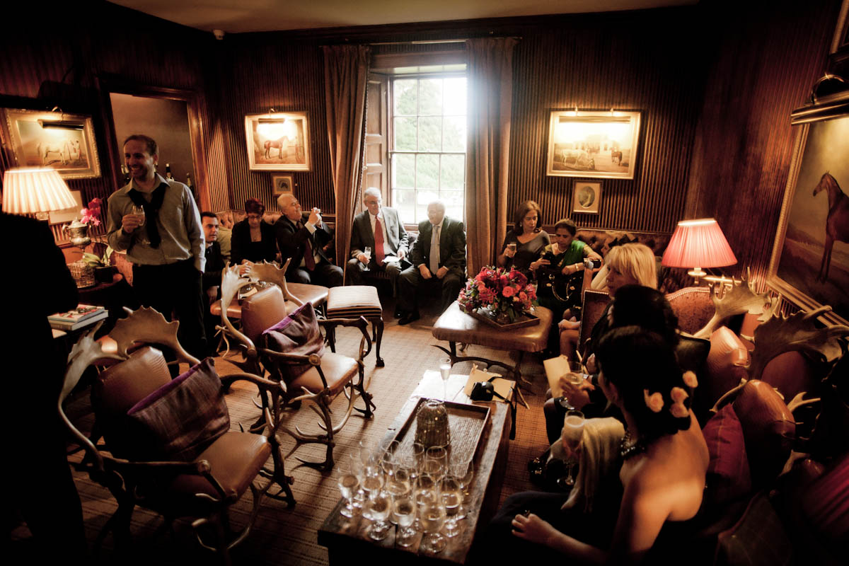 guests relax after wedding cermony at prestonfield house in edinburgh