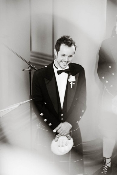 happy groom smiling at wedding at signet library edinburgh