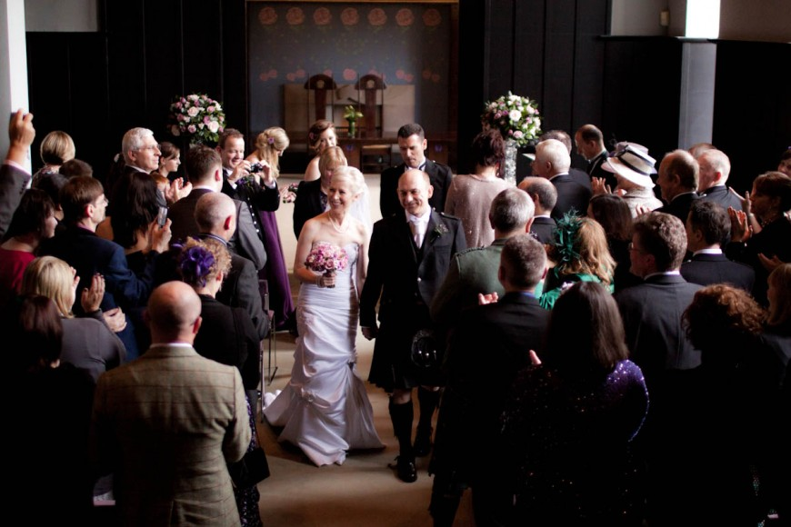 bride and groom walk up aisle after wedding ceremony