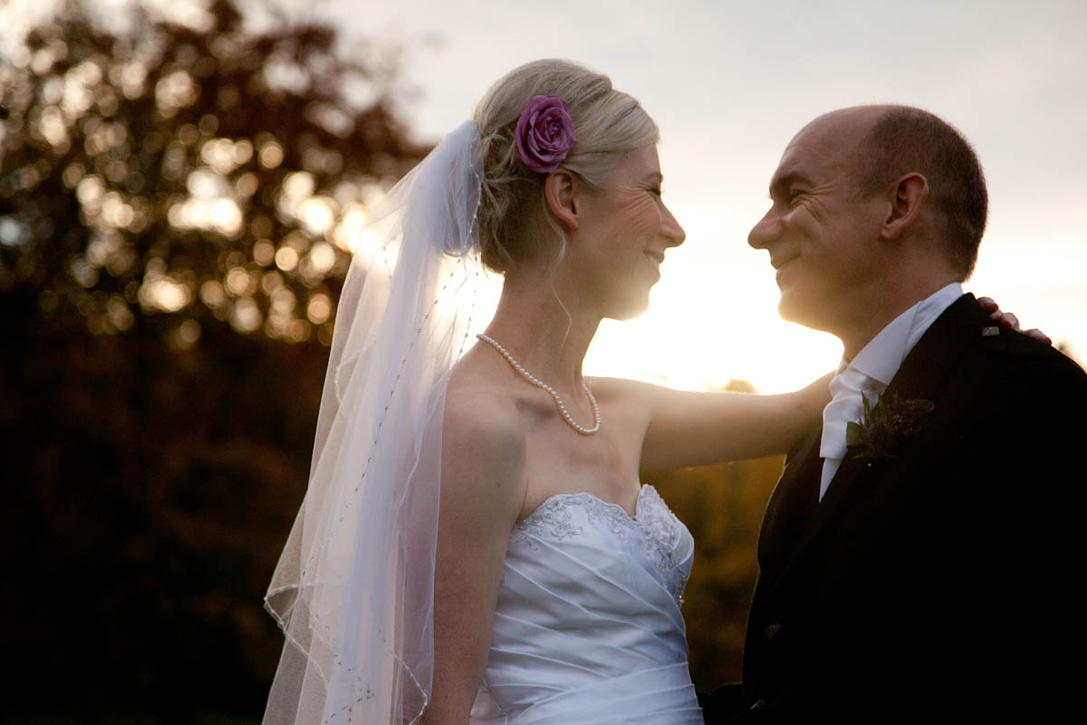 bride and groom in autumn sunset