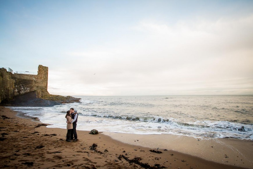 engagement photography st andrews kiss on beach