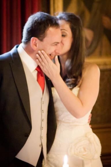 bride kisses groom at wedding at drummuir castle