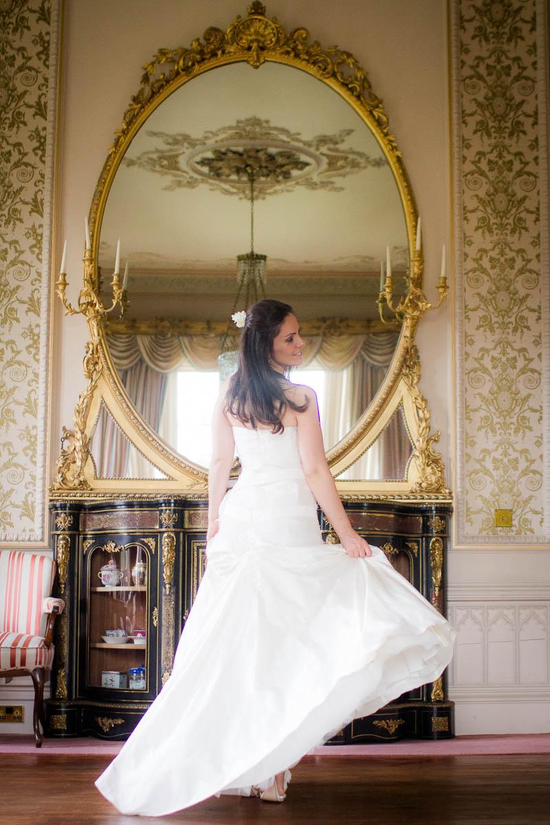 bride with mirror at wedding at drummuir castle