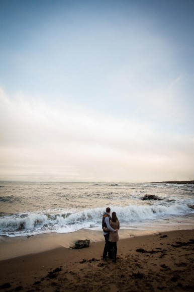 engagement photography st andrews beach looking out to sea