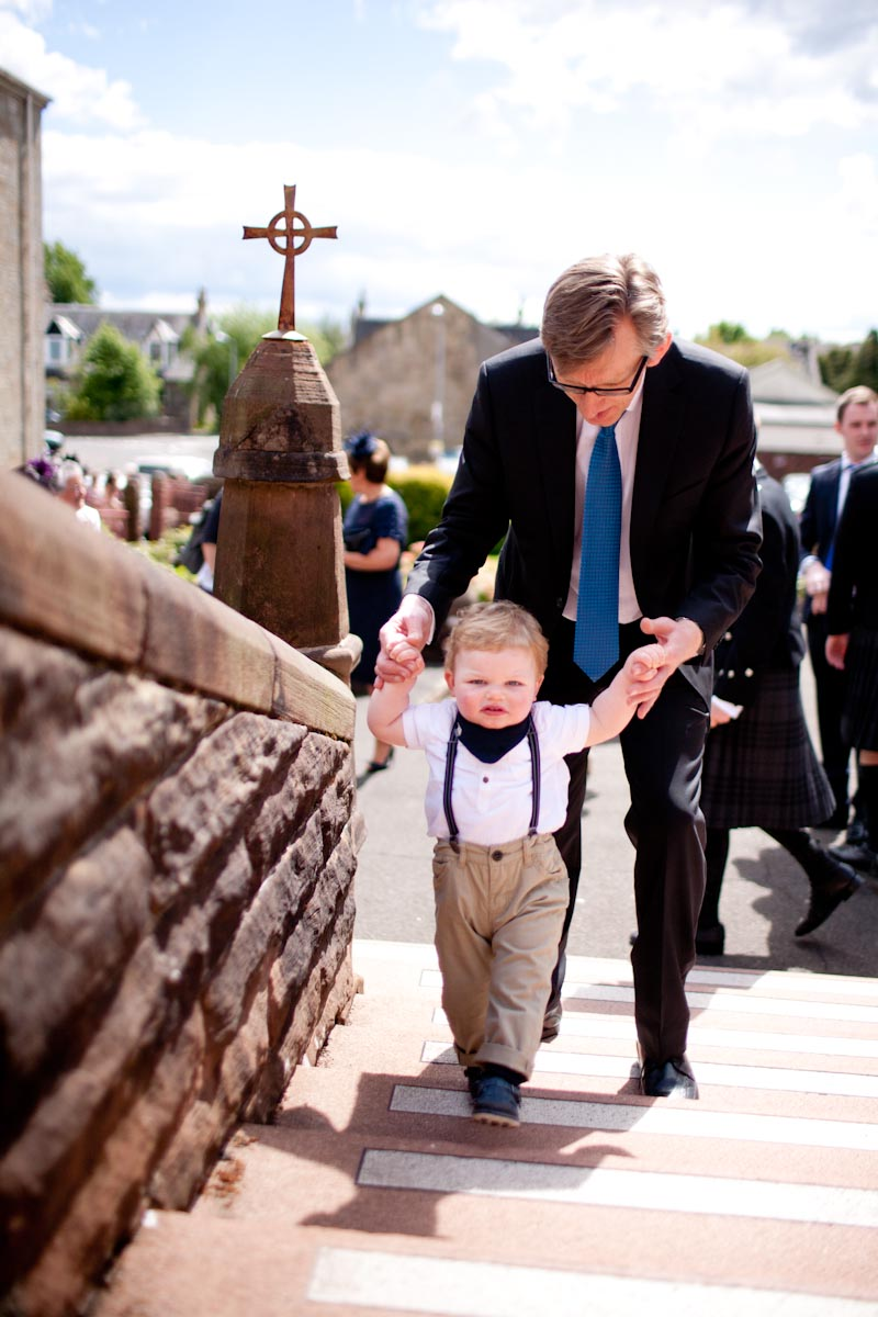 small boy arrives at wedding at church