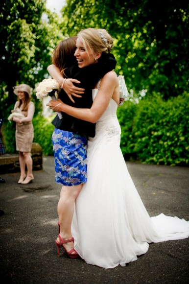 bride hugs friend outside