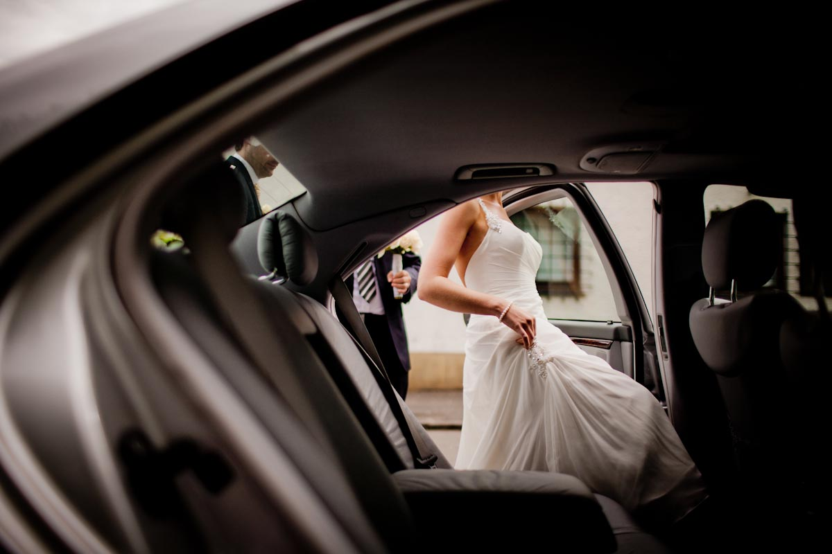 bride gets into wedding car