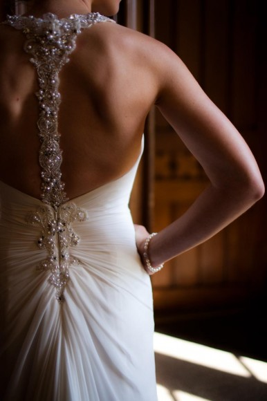 bride in sparkly jewelled wedding dress from behind
