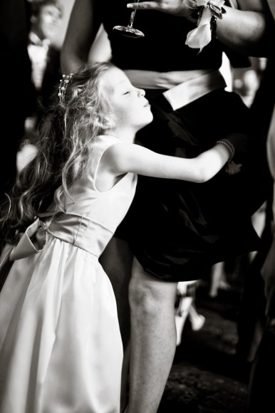 flower girl hugs mother