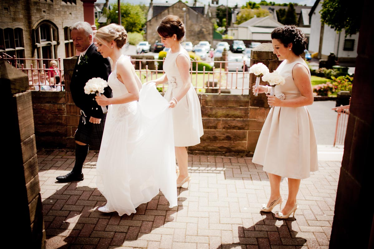 bride and bridesmaids in sunshine