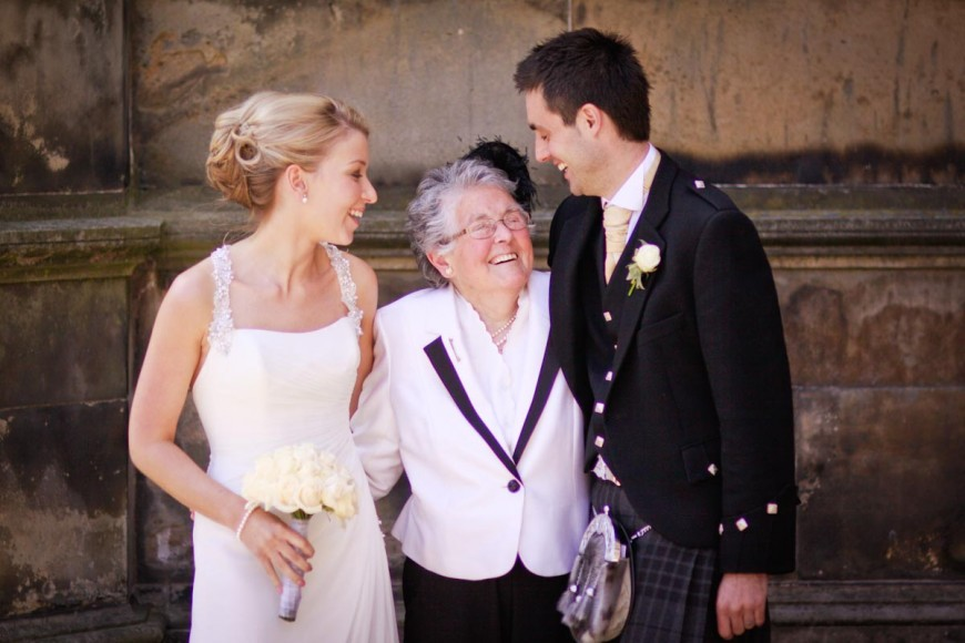bride and groom get advice from grandmother