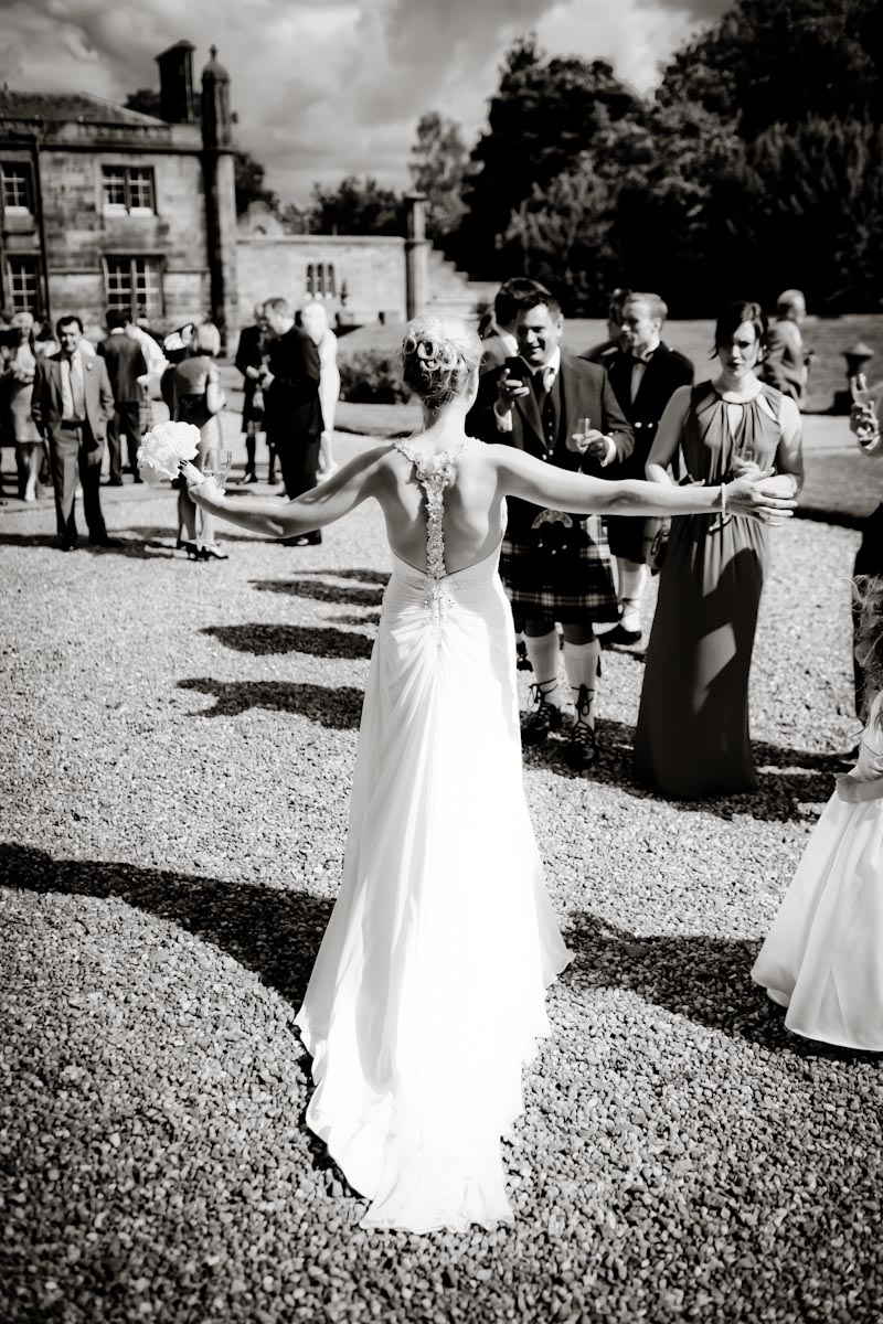 bride with arms held wide at Mar Hall