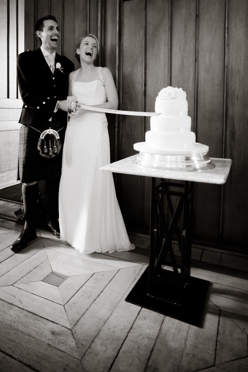 wedding cake cut with sword
