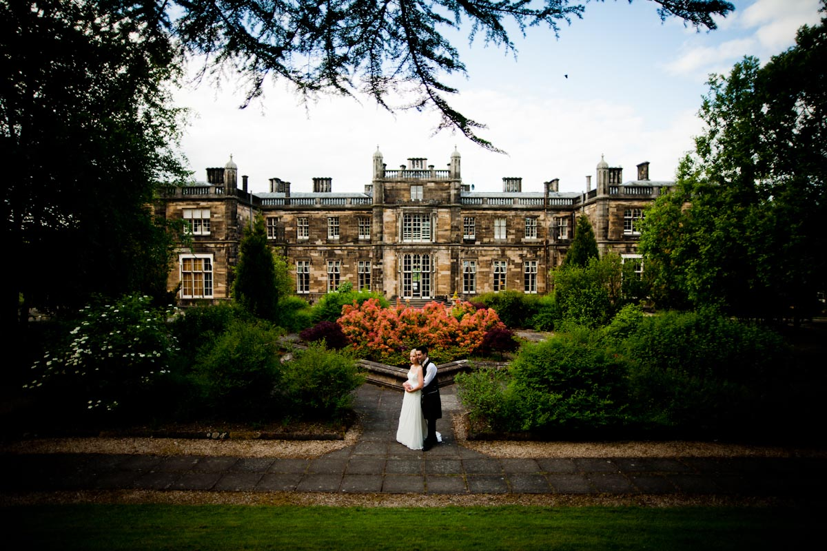 bride and groom in gardens of mar hall in glasgow