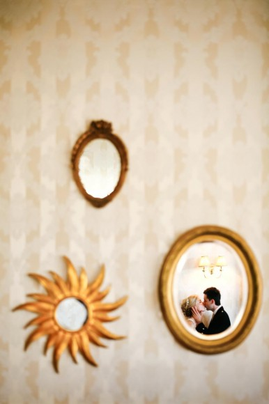 bride and groom kiss reflection in mirror