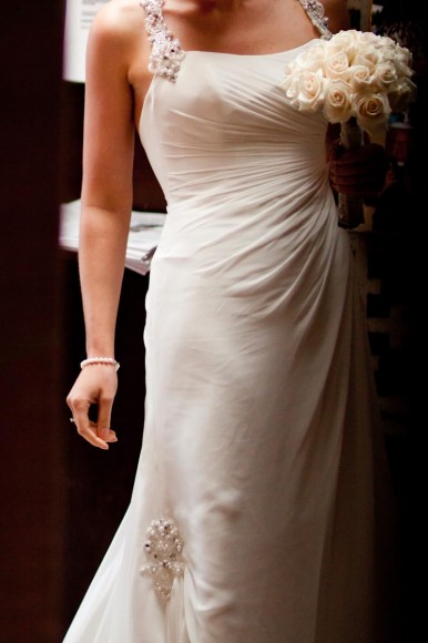 torso shot of bride in wedding dress with flowers