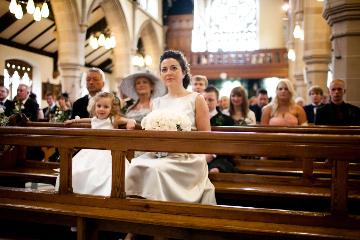 bridesmaids in pew at catholic churchwedding