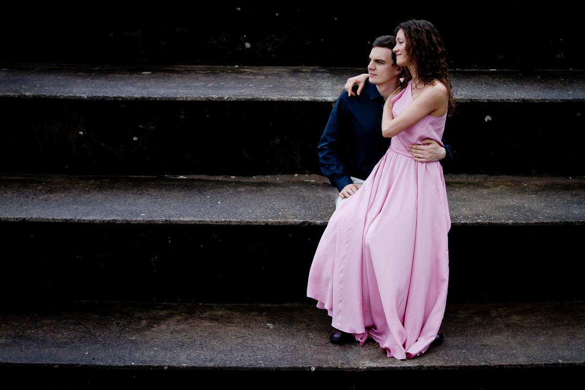 engagament photography portobello beach sitting on steps pink dress