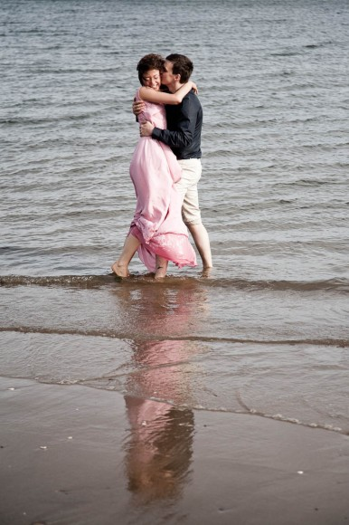 engagement photography portobello beach paddle in sea