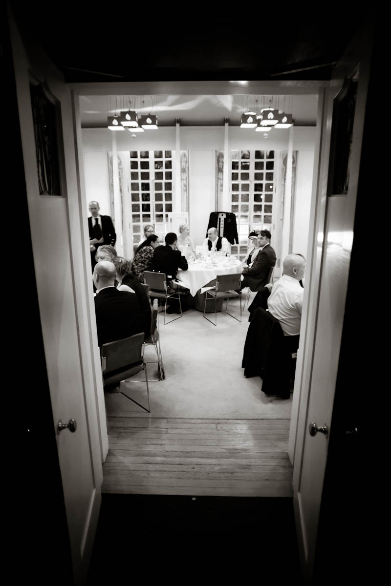 wedding reception at house for an art lover in glasgow black and white through doorway