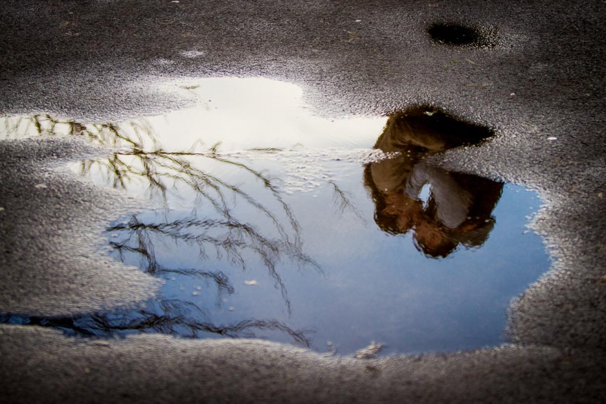 engagement photography reflection in puddle