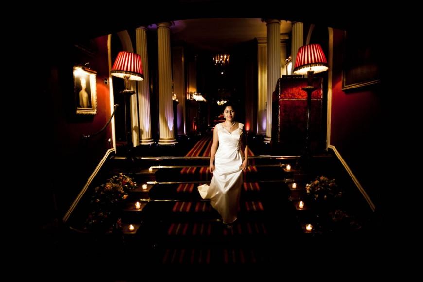 bride walks down stairs at prestonfield house in edinburgh