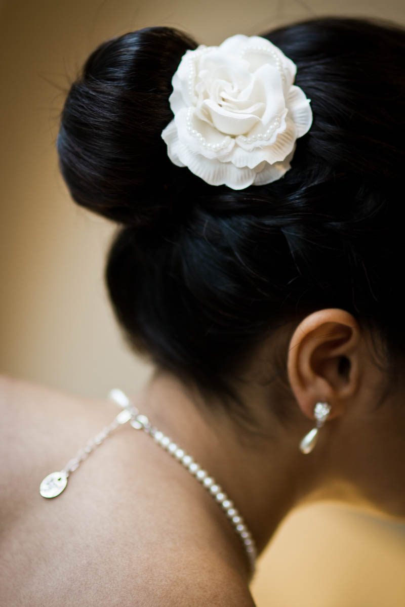 bridal hair with white flower and pearls