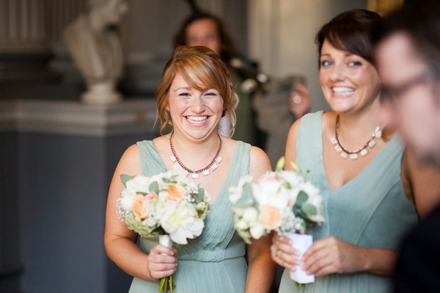 bridesmaids in blue dresses smiling at wedding in signet library edinburgh