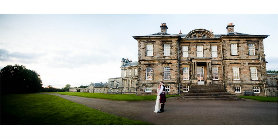 Bride and Groom standing outside Hopetoun House