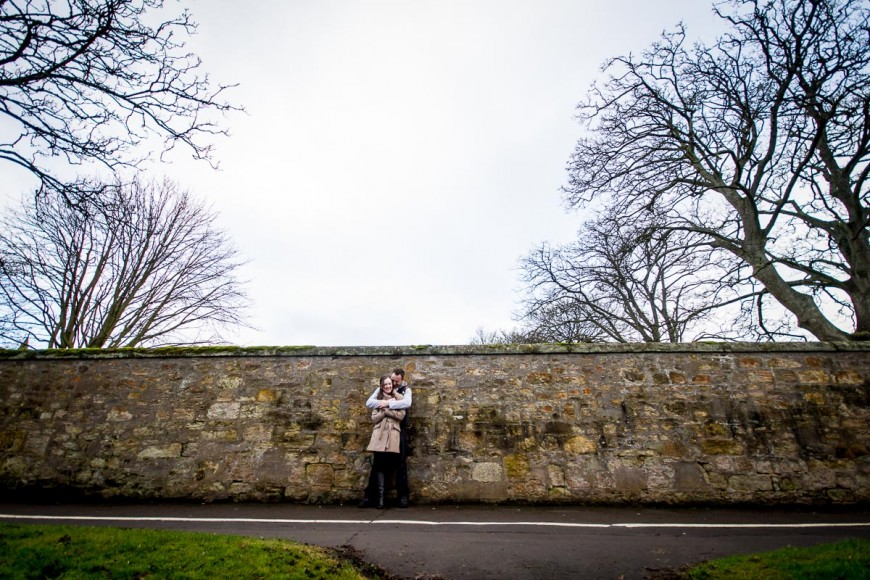 engagement photography stone wall and trees in st andrews