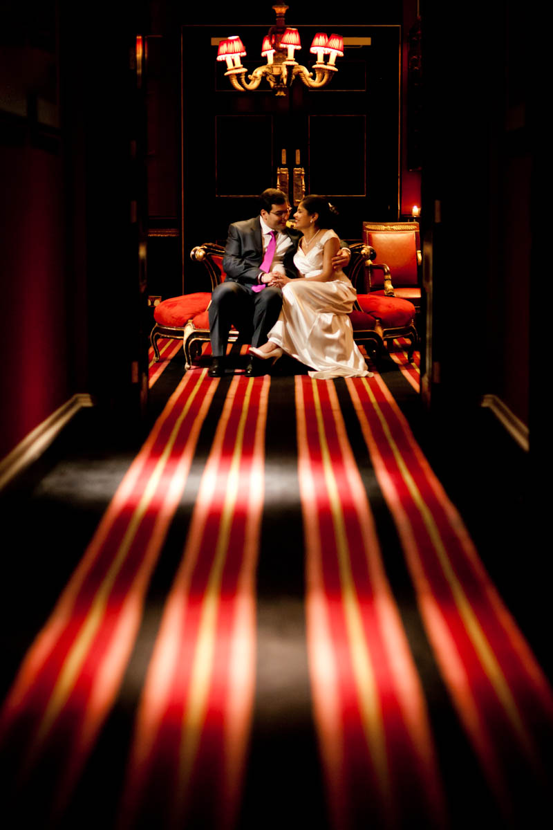 bride and groom with red striped carpet at prestonfield house in edinburgh