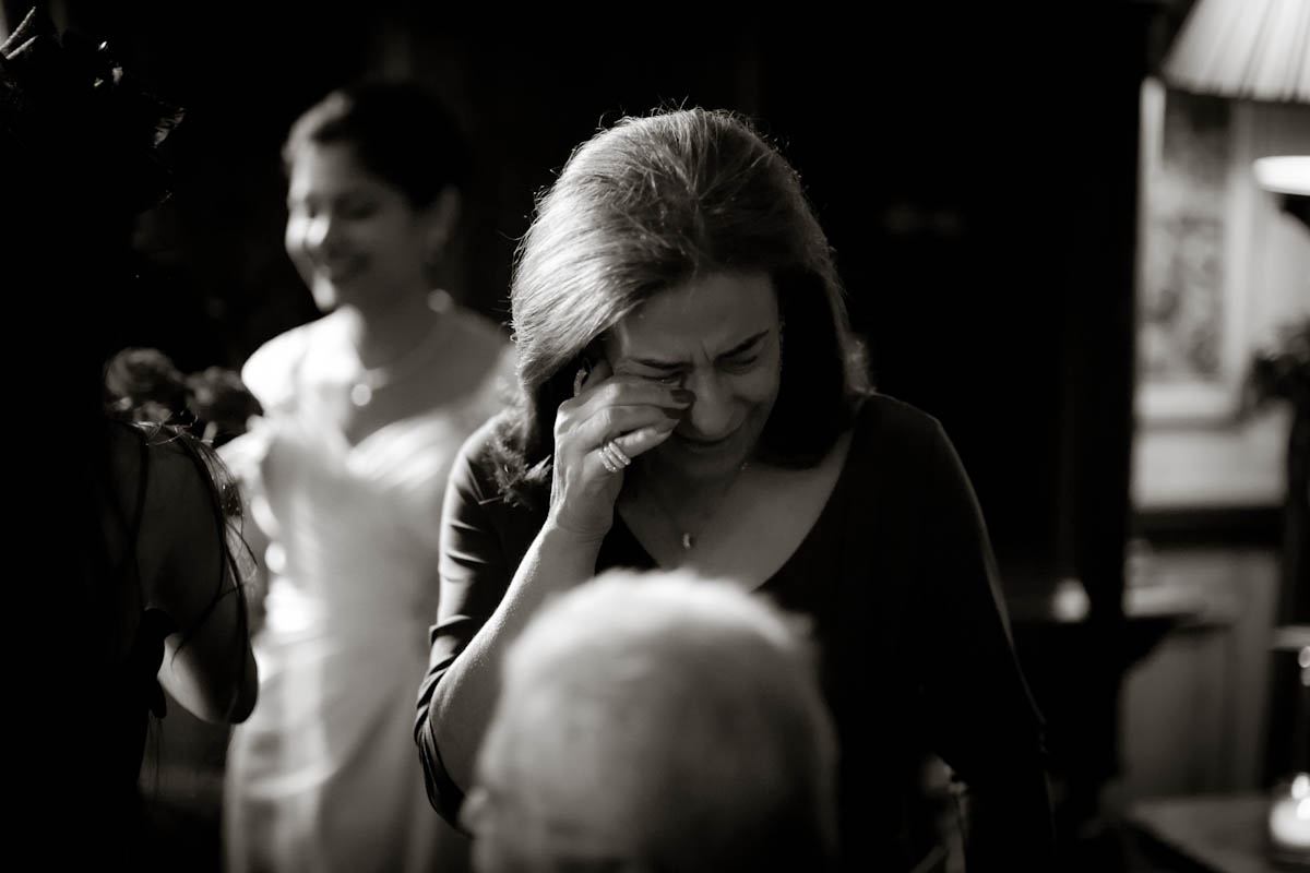 woman cries with joy at wedding