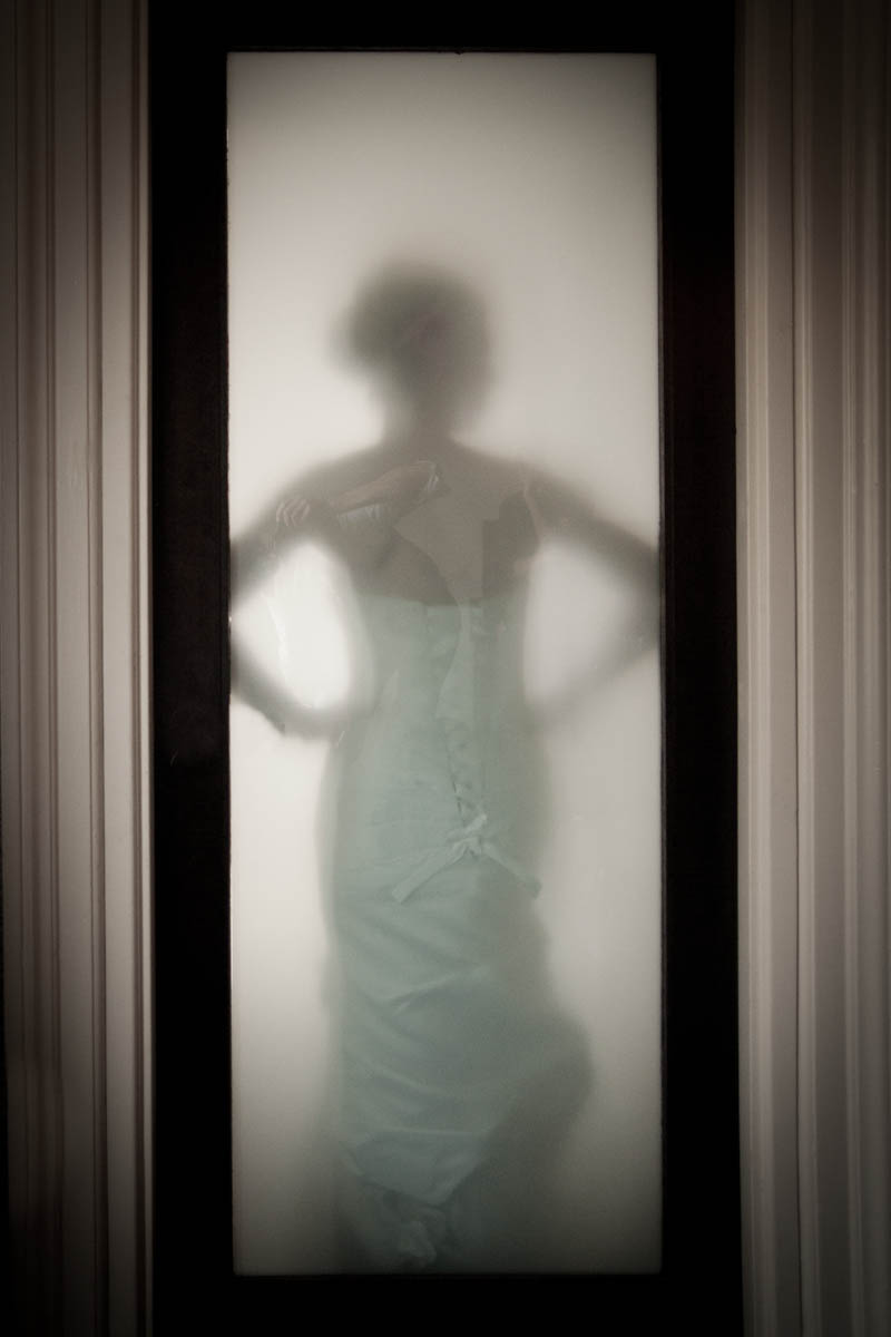 bride behind frosted glass
