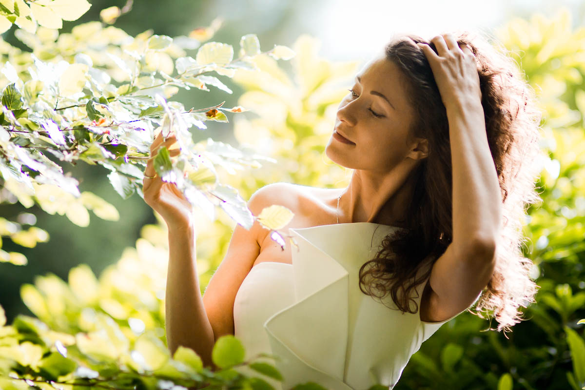 bride with leaves in sunlight