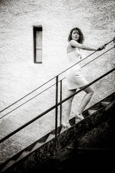 bride climbs outside steps