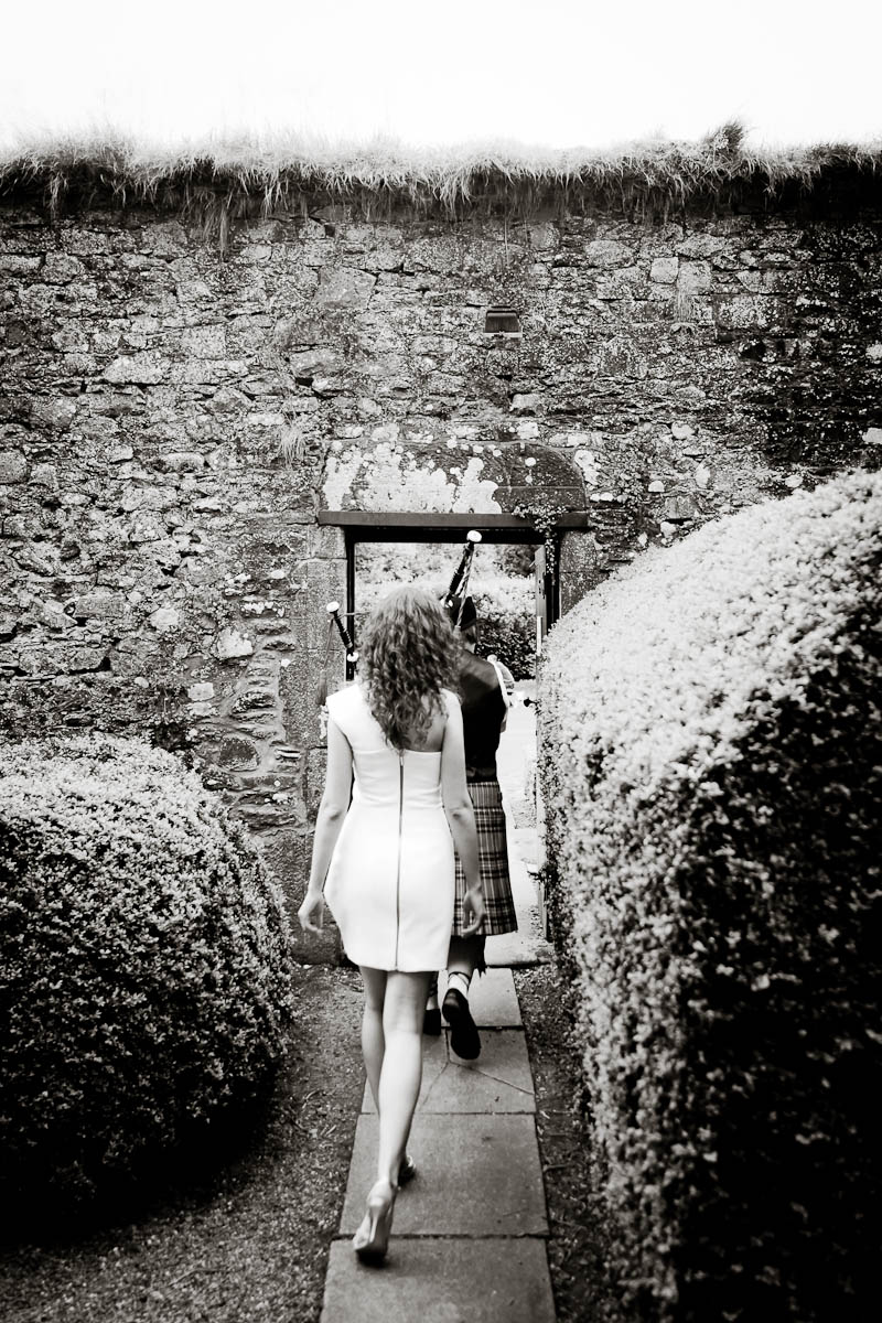 bride and groom in walled garden at traquair house