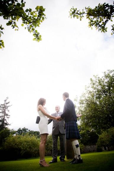 bride and groom make vows in garden