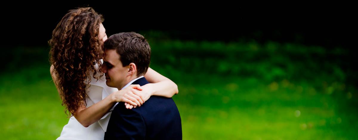 bride on groom's knee