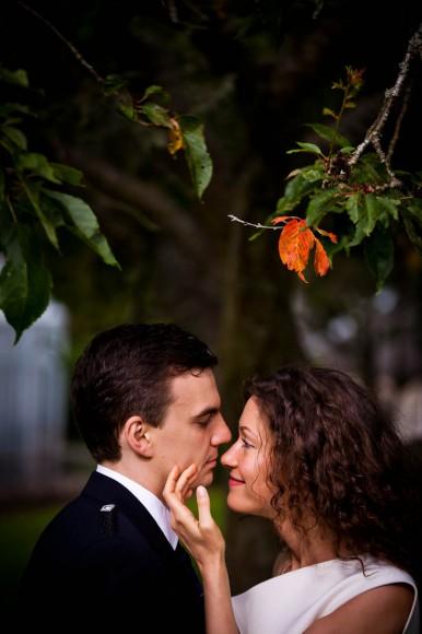 bride and groom beneath tree